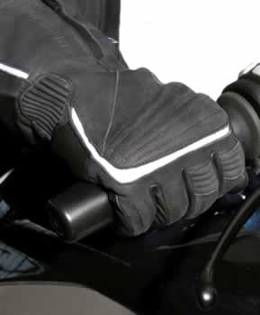 Picture of glove on rider gripping throttle.